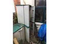 Two plastic garden storage cupboards