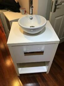 Bathroom basin with stand and taps