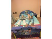 Toy story toddler bed with mattress, mattress protector and toy story duvet and duvet cover