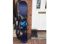 Snowboard with bindings, boots and carry bag