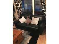 Black leather sofas - 2x2 seater sofa and 3 seater sofa with recliners
