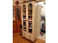 Tall glass front display unit with drawers