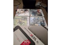 Nintendo 3ds XL + box + charger + four 3ds games