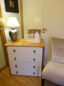 Sturdy chest of four drawers.