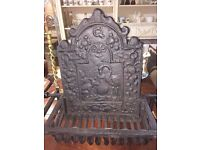French fire grate with dog legs and 17th c. fire back