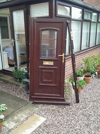 For sale upvc front door with frame.