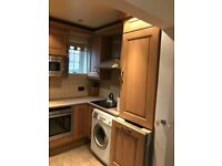 Assorted kitchen cabinets, sink unit and granite worktops