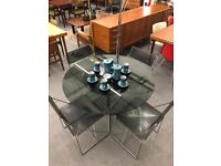 Mid Century Modern dining table and chairs. Retro piece good vintage condition.