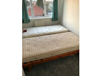 2 x wooden single beds - hardly used
