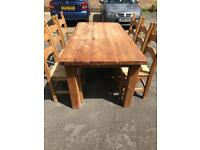 Very Large very solid pine table and six chairs