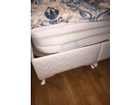 Double bed base with white leather headboard and storage