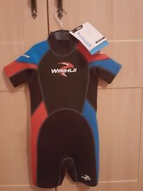 Wetsuit age 7-8. New. Labels in place.