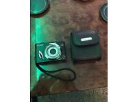 Sony Cyber Shot DSC-W17 Digital Camera - A Special Black Edition with Black Leather Case