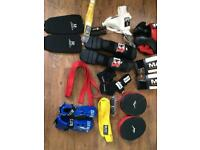 Foot protector , yellow belt, red belt, head protector, boxing gloves, hands wr
