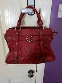 Dark red handbag