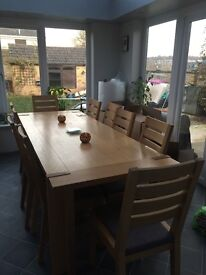 Solid oak table and ten chairs