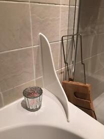 Bath water saver - stops water hitting the floor