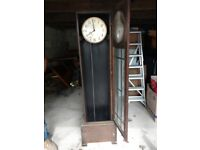 Old grandfather clock for restoration, no innards except for pendulum and weight cases