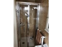 Brand new bi-fold shower screen