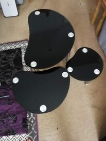 Black Glass nest of tables. Good condition.
