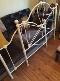Cream wrought iron small double bed