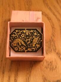 Ladies genuine vintage black and gold brooch