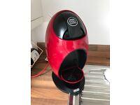 Red Nescafé Dolce Gusto coffee machine DeLonghi