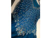 Long blue diamanté dress