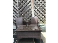Like new two brown rattan chairs and table