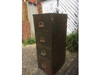 Metal filing cabinet used in shed for storage for garden tools and diy stuff