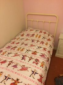 Single iron cast bed with mattress nearly new