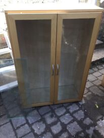 Ikea light wood display cabinet with glass shelves