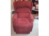Celebrity Westbury electric riser recliner armchair in Claret red. Three year warranty remaining.
