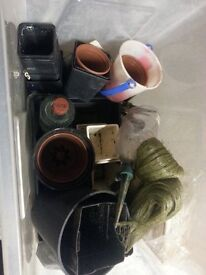 Storage box with garden items plastic & ceramic pots, nets, root watering spikes, etc