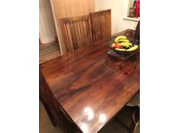 Solid wood dining table & six chairs selling due to buying a smaller property