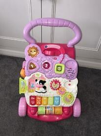 Pink musical walker