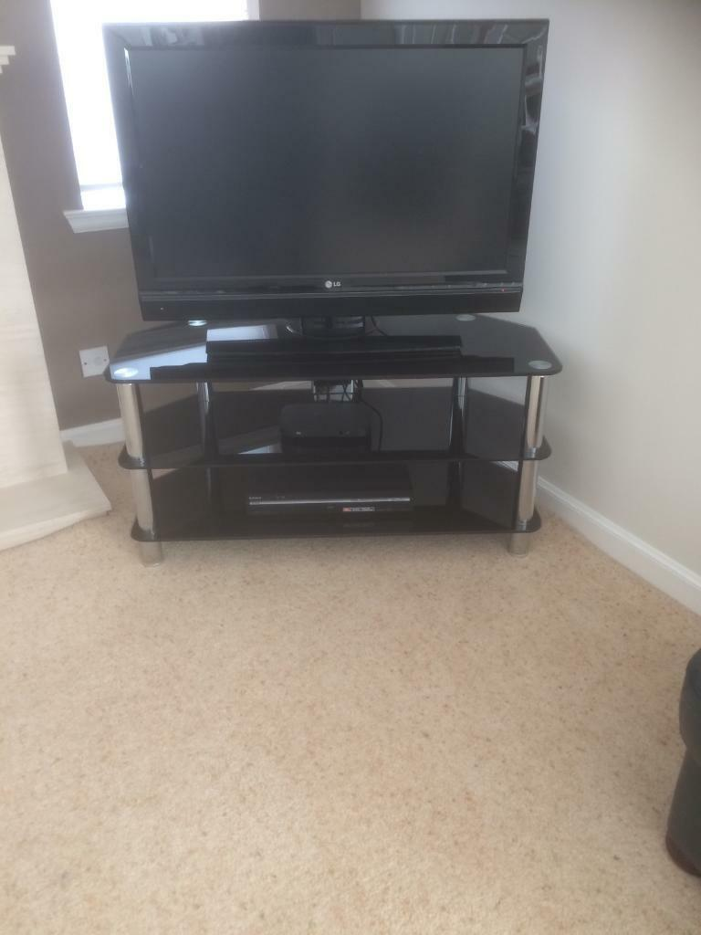 TV stand with 2 additional shelves. Chrome legs and shelves in black glass