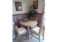 Extendable Dining Table and Four Chairs.
