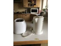 Rowenta Kettle and Toaster- white in colour.