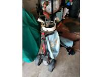 Half set of Golf clubs. Inc trolley, bag and stand