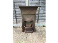 Castiron fireplace Ideal for somebody doing a home renervation project . Comes with front grill for