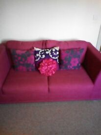 VGC double sofa bed...deep pink with matching cushions £100