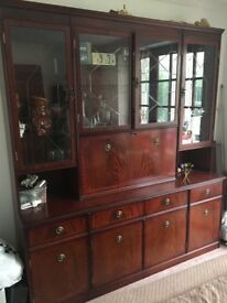 Large mahogony wood cabinet with bar for drinks and storage purposes
