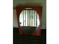 Mirror with oval glass
