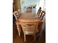 Lovely used extending wooden table and 6 chairs of which 2 are carvers.