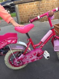 girls 12inch bike , sweetie brand and punk in colour comes with dolly seat at the back