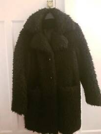 Woman's black fluffy coat size 12