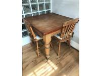 Victorian pine dining table and two pine chairs