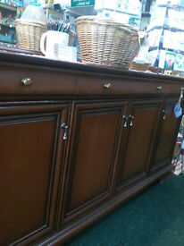 Stag Quality sideboard and wall mirror. Mahogany finish lined drawers and four under cupboards