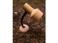 Small reading lamp. Dark cream in colour.
